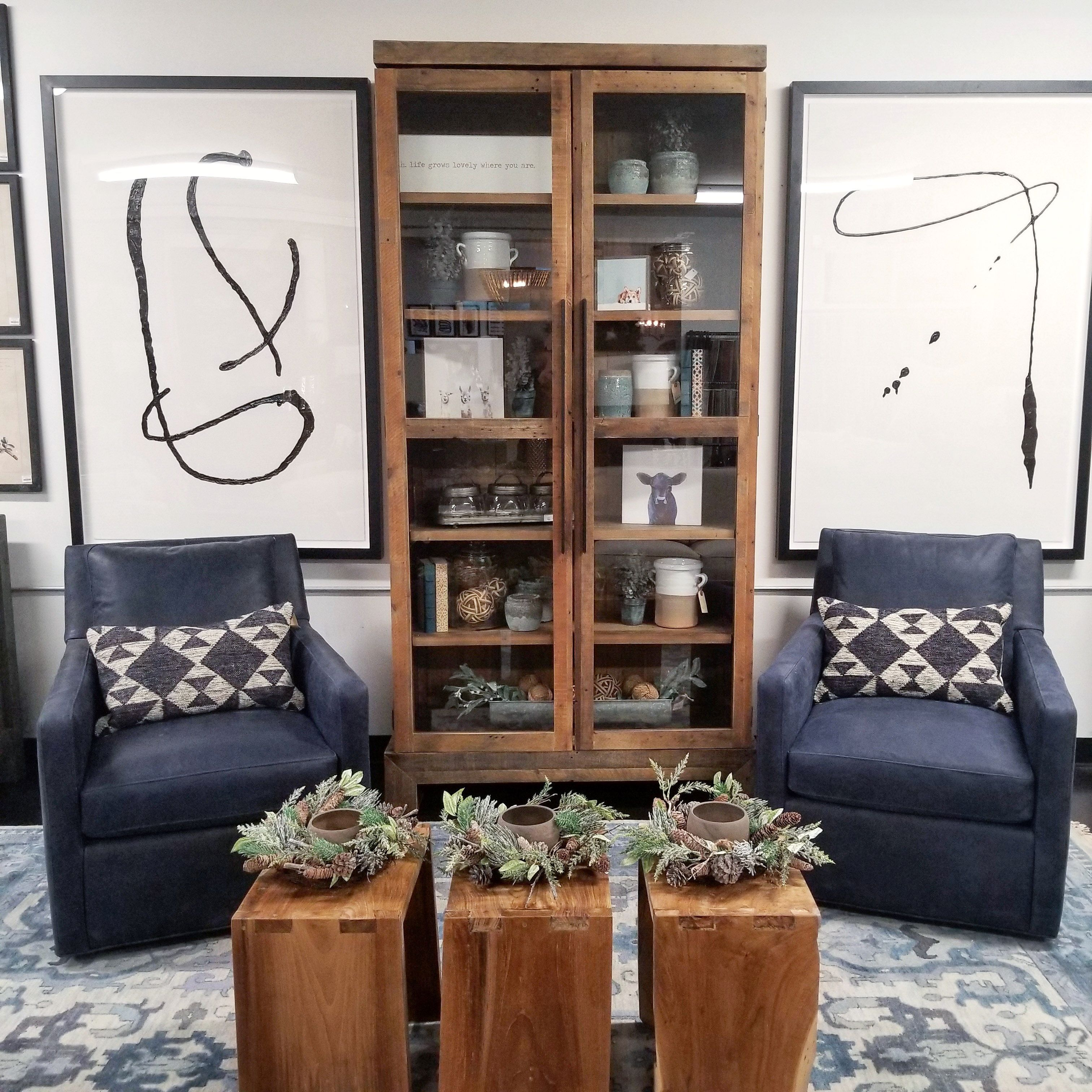 Rustic Meets Modern In This Cozy Living Room Setting The Jaxon Swivel Chairs Are Wrapped I Swivel Chair Living Room Cozy Living Rooms Mid Century Office Chair