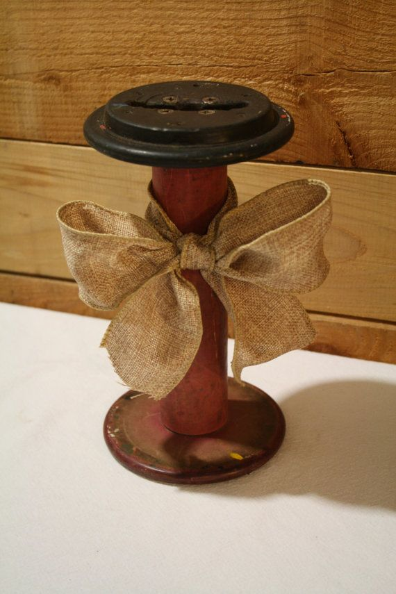 This piece has so much character. The red adds the perfect pop of color. This vintage spool is a perfect home decor piece just as it is or you can put a 3-wick candle on top of it. Great for a mantle or coffee table.