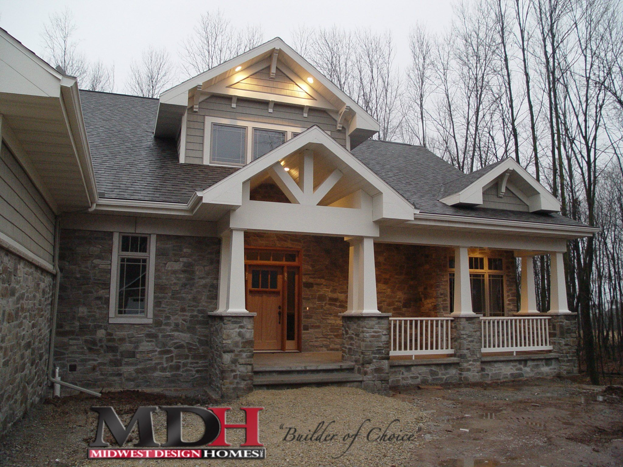 Craftsman style exterior on a custom mdh build features Craftsman style gables