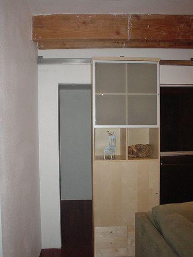 The Door Partway Open Sliding Door Bookshelves Ikea And Door