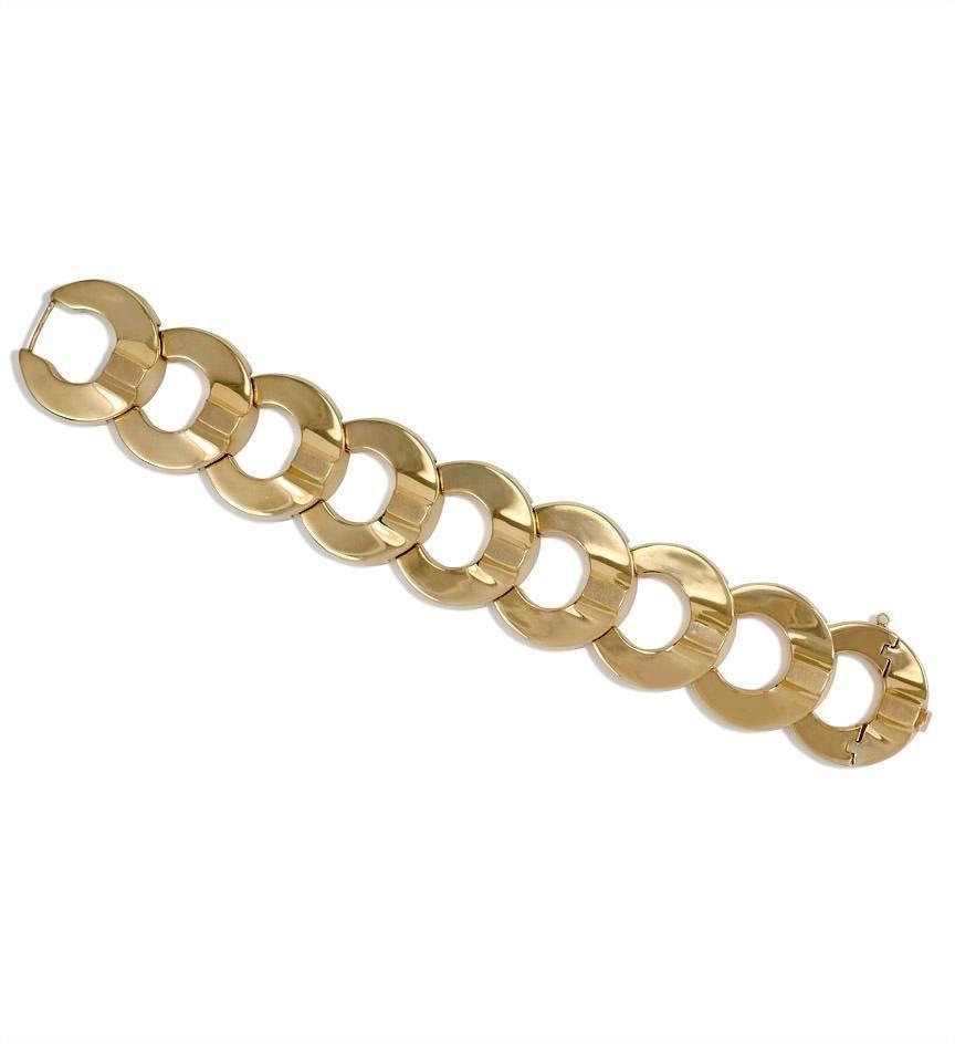 A Retro gold bracelet of horseshoe link design, in 14k.