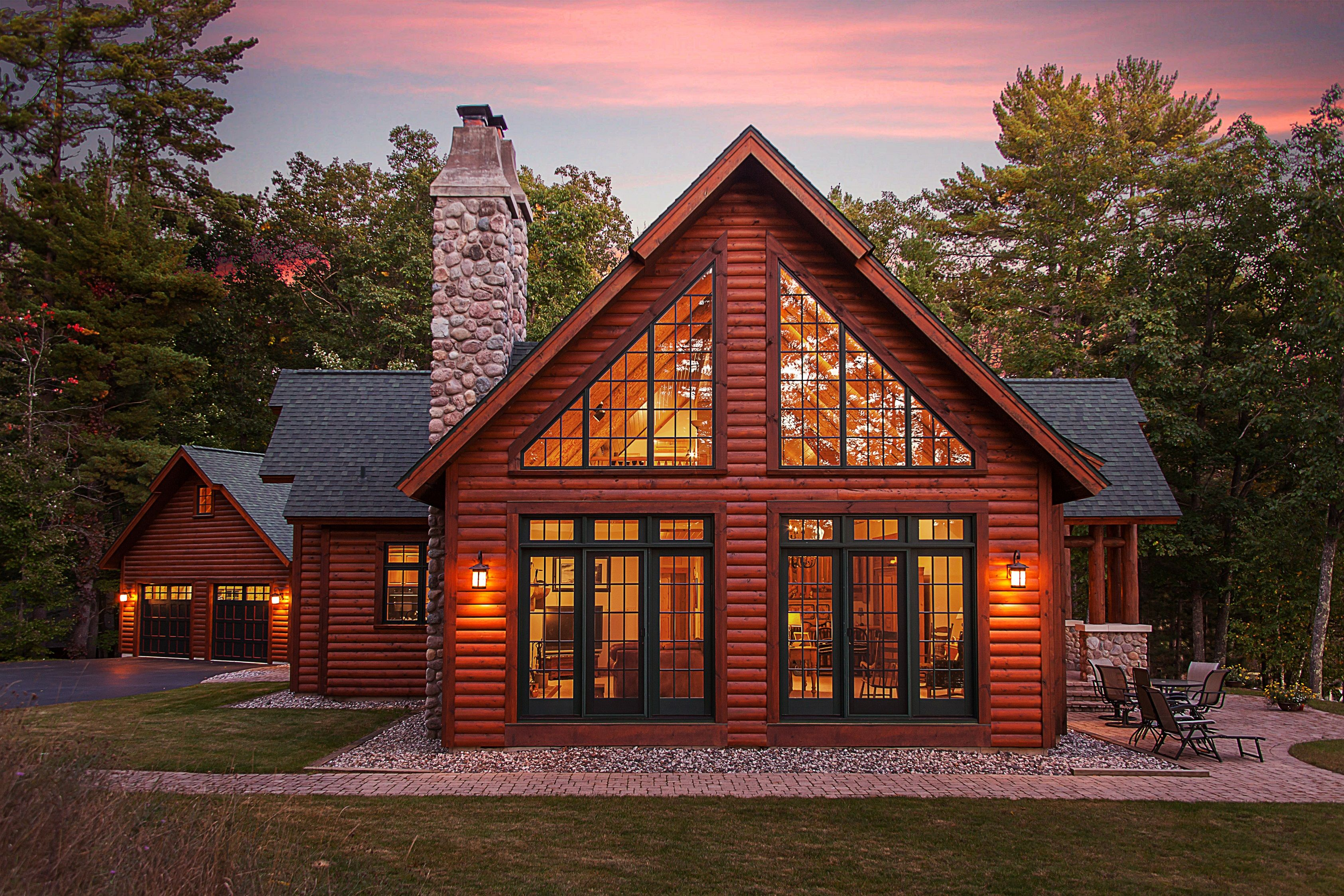 Hybrid Log Lake Home. Side View Of Large Patio Doors And
