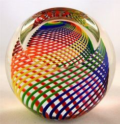 Dale Chihuly  PAPERWEIGHTS | Rainbow glass paperweight.