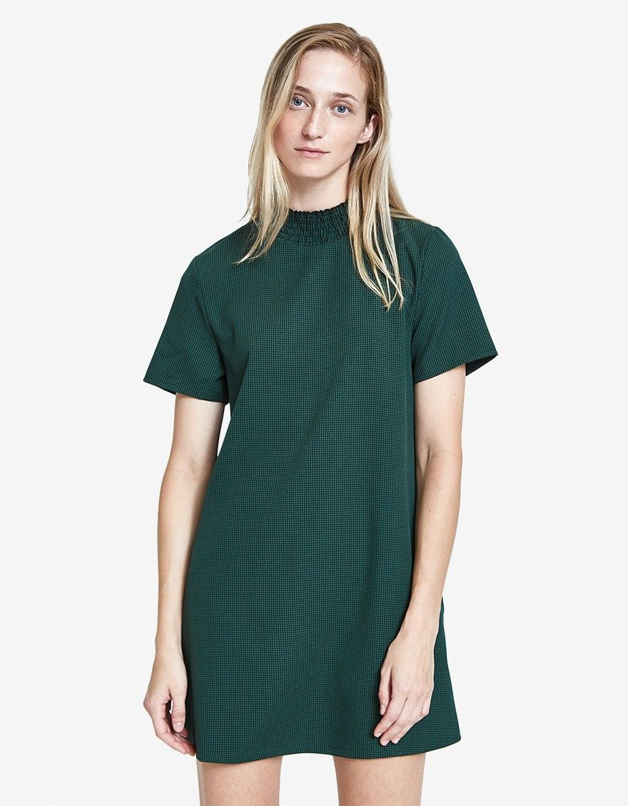 3fca5b8da8f2 Mini dress from Farrow in Green. Smocked collar. Back button closure with  keyhole below. Short sleeves. Straight hem. Unlined. Mid-thigh length.