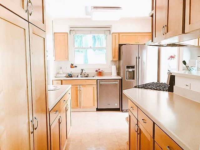 A traditional kitchen with brown cabinets and neutral ...