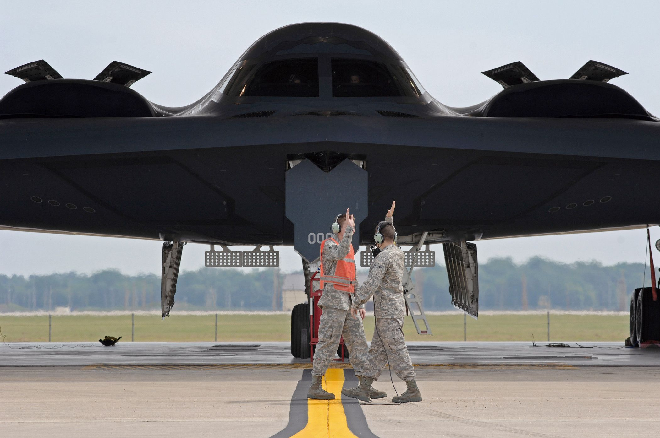 A pair of air force guys giving each other a high five