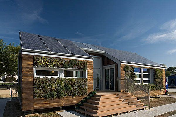 Super Cool Green Home Designed For Cold Canadian Winters Complete With A Green Wall For Improved Insulation Solar Panels Best Solar Panels Solar Energy Diy
