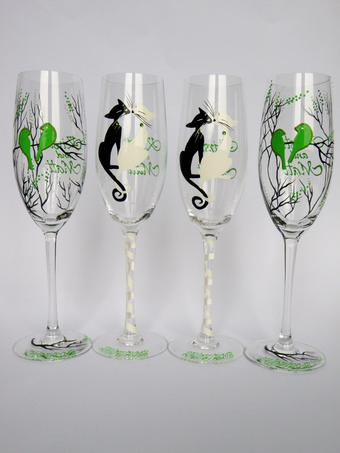 Hand painted Wedding Toasting Flutes Set of 4 Personalized Champagne glasses Black trees and Lime green birds, Black & White cats. $92.00, via Etsy.