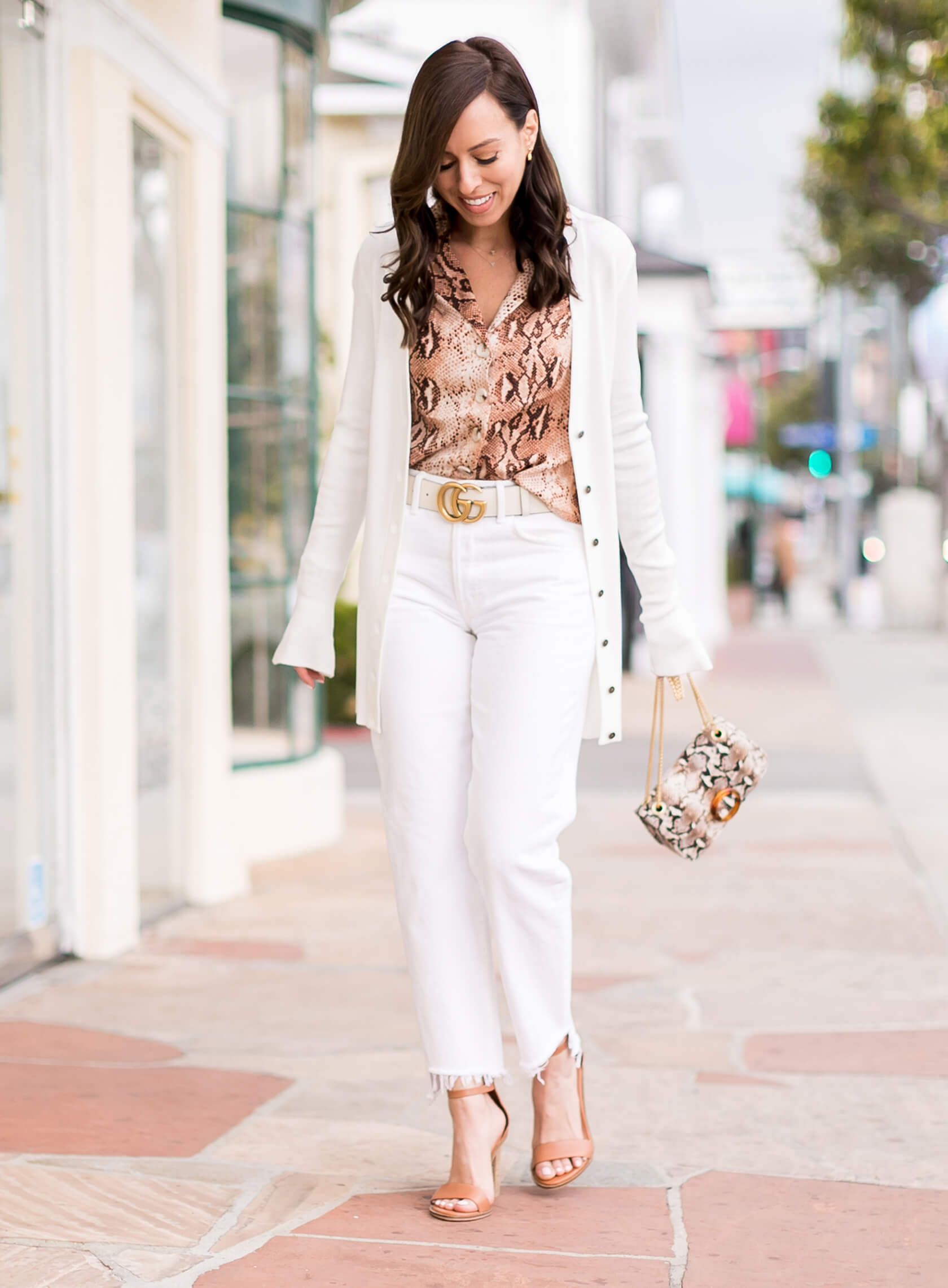 a68aeae5ba86 Sydne Style shows how to wear white jeans for spring outfit ideas with the  snakeskin trend #snakeskin #gucci #guccibelt #cardigan #casualstyle #white # jeans ...
