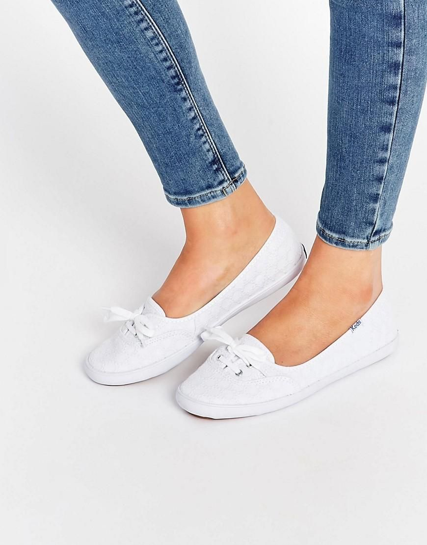 67b6b4170a ... Shoes & Bags for Women. Keds   Keds Teacup Eyelet White Lace Plimsoll  Trainers at ASOS