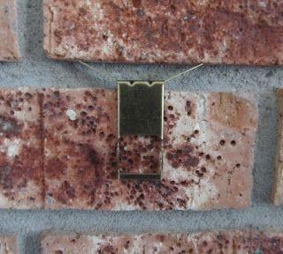 Hang Items On Brick Without Drilling Brick Brick Hooks Brick Wall