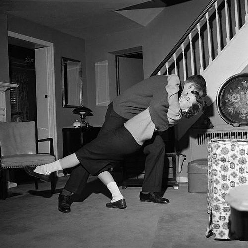 Living Room 1960 a young couple dancing in their home living room. friendship