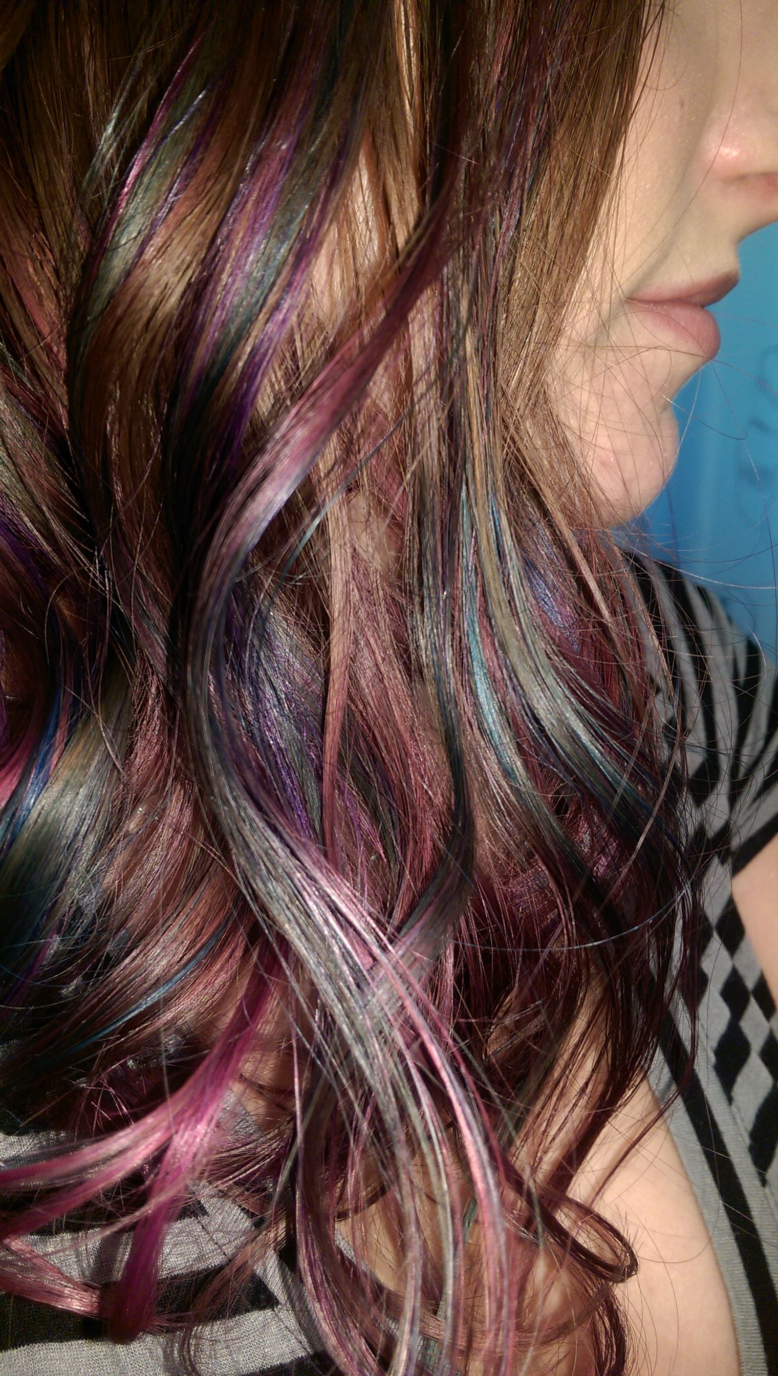 "oil slick"" multi-colored hair dyed and cut a-line styled. 