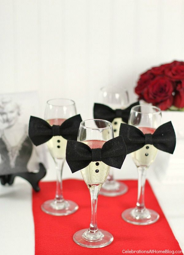 """Decorate fluted glasses with mini bow ties and """"buttons"""" to represent all those luxe tuxes on the red carpet."""