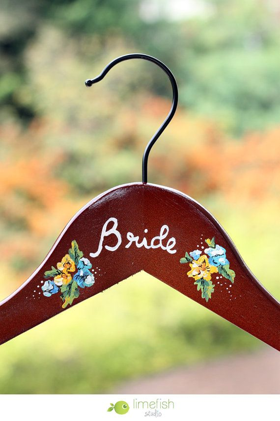 "Custom Hand-Painted Bride Hanger... Treat that special Bride (or treat yourself) to a unique memento for that special day! These wooden ""BRIDE"" hangers are made-to-order with the flower colors of your choice."