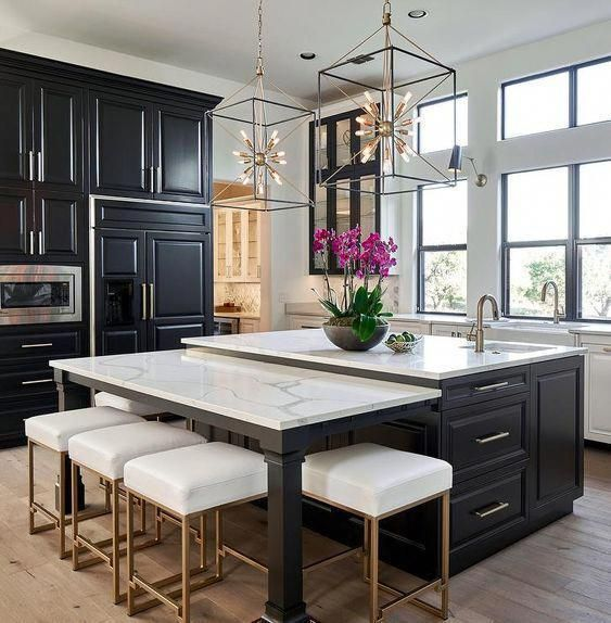Modern Urban Rooms such as this gorgeous black and white kitchen with dark cabinets, marble counter tops and gold accents – South Shore Decorating Blog #kitchendecor #kitchenideas #kitcheninspiration #modernkitchen