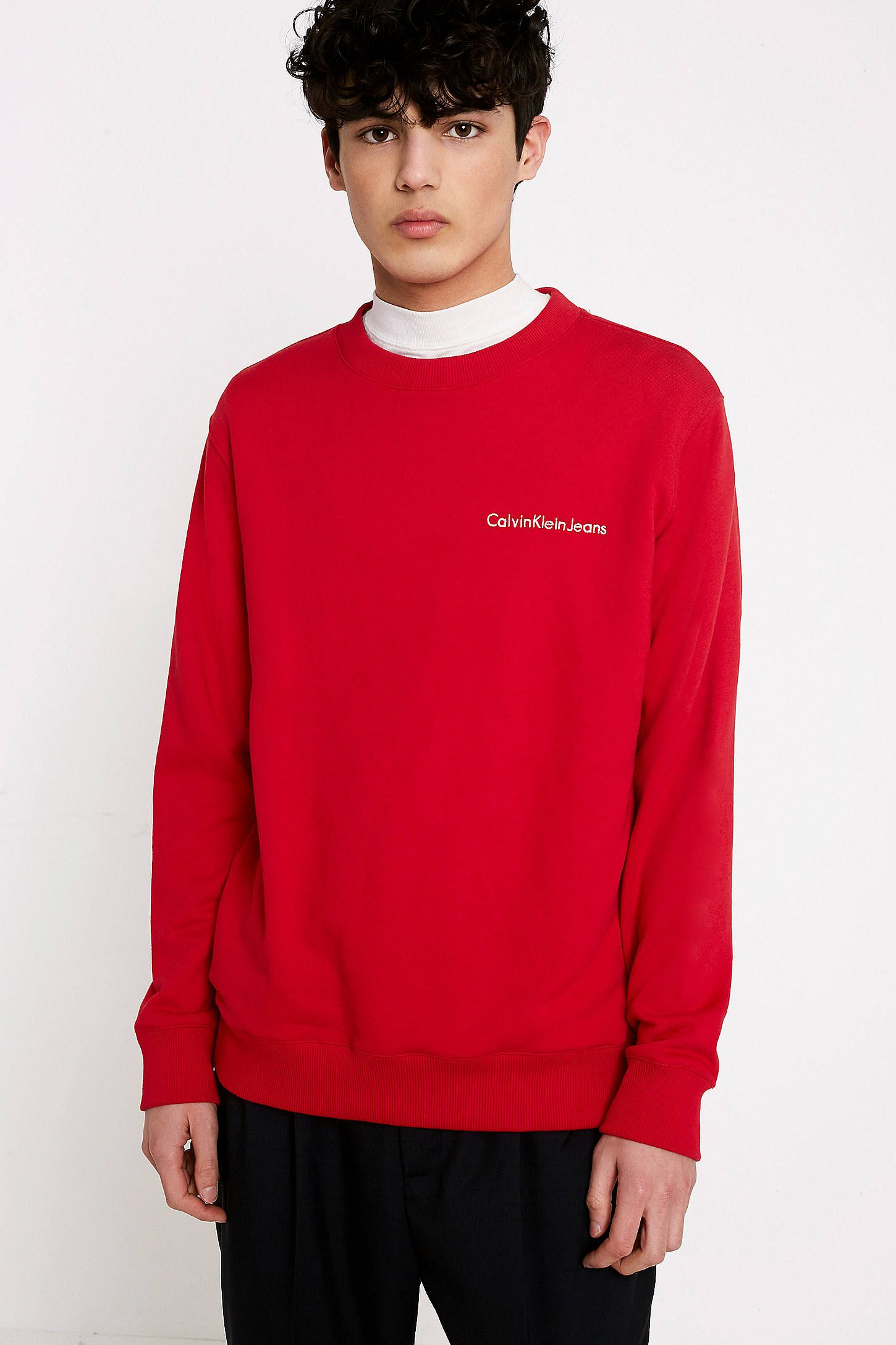 33f10de0 Shop Calvin Klein Jeans Horos Red Logo Sweatshirt at Urban Outfitters  today. We carry all the latest styles, colours and brands for you to choose  from right ...