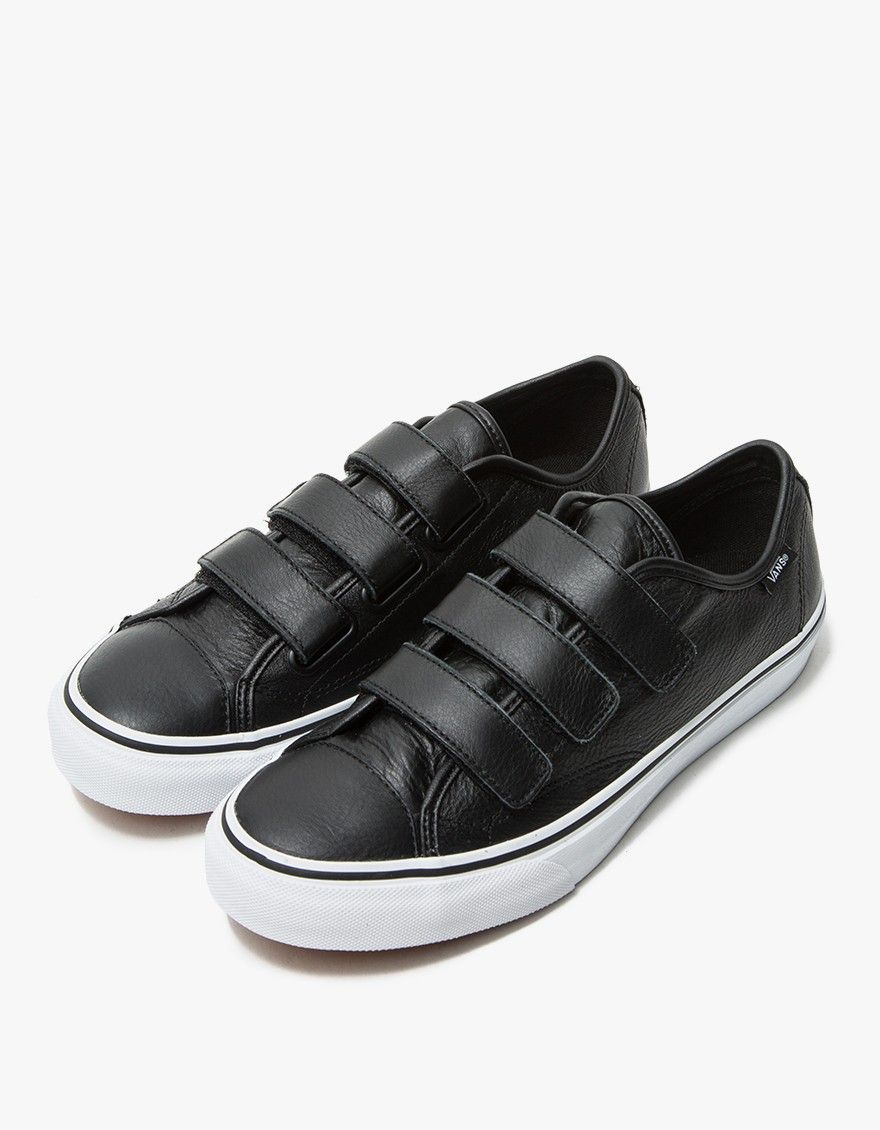da02d825b7 Retro-inspired sneaker from Vans in Black. Textured leather upper. Three  strap Velcro closure. Logo detailing at left ankle and heel. Canvas lining.