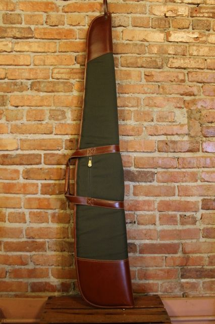 Men's canvas and leather gun bag.  Made with forest green canvas and buffalo hide leatherFoam padded with soft fleece lining