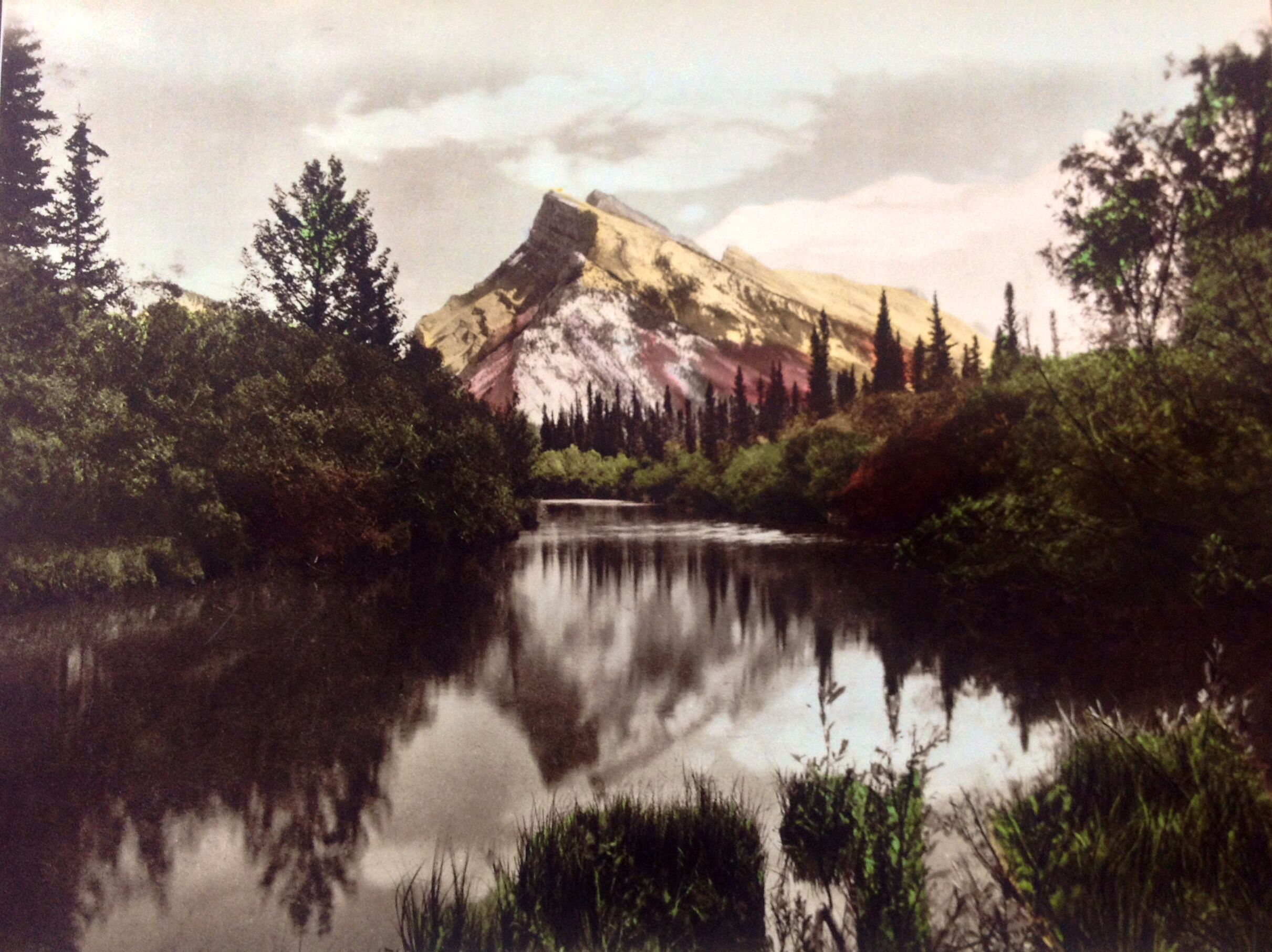 Vintage photo hand colored....Mt. Rundle, Banff, Alberta Canada. Named after a missionary to the Indians, he journeyed into the Rockies in 1841, being the first white man to visit the upper Bow Valley.
