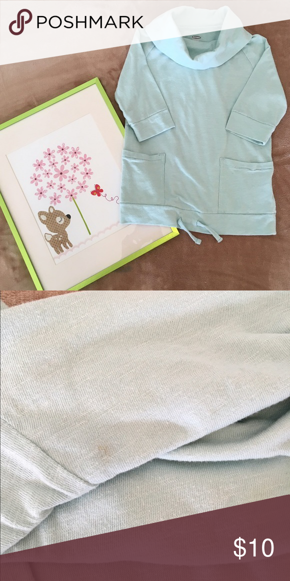 Old navy 3/4 sleeve cowl neck shirt size 4T So many cute details on this shirt! Mint green cowl neck 3/4 sleeve in size 4T. Two front pockets with a drawstring detail to cinch if needed. 60% cotton/40% polyester. A small stain on collar, barely noticeable (see pic). Otherwise, in very good condition, no known holes or defects. Shows normal wear & wash. From smoke & pet free home. Old Navy Shirts & Tops Tees - Long Sleeve