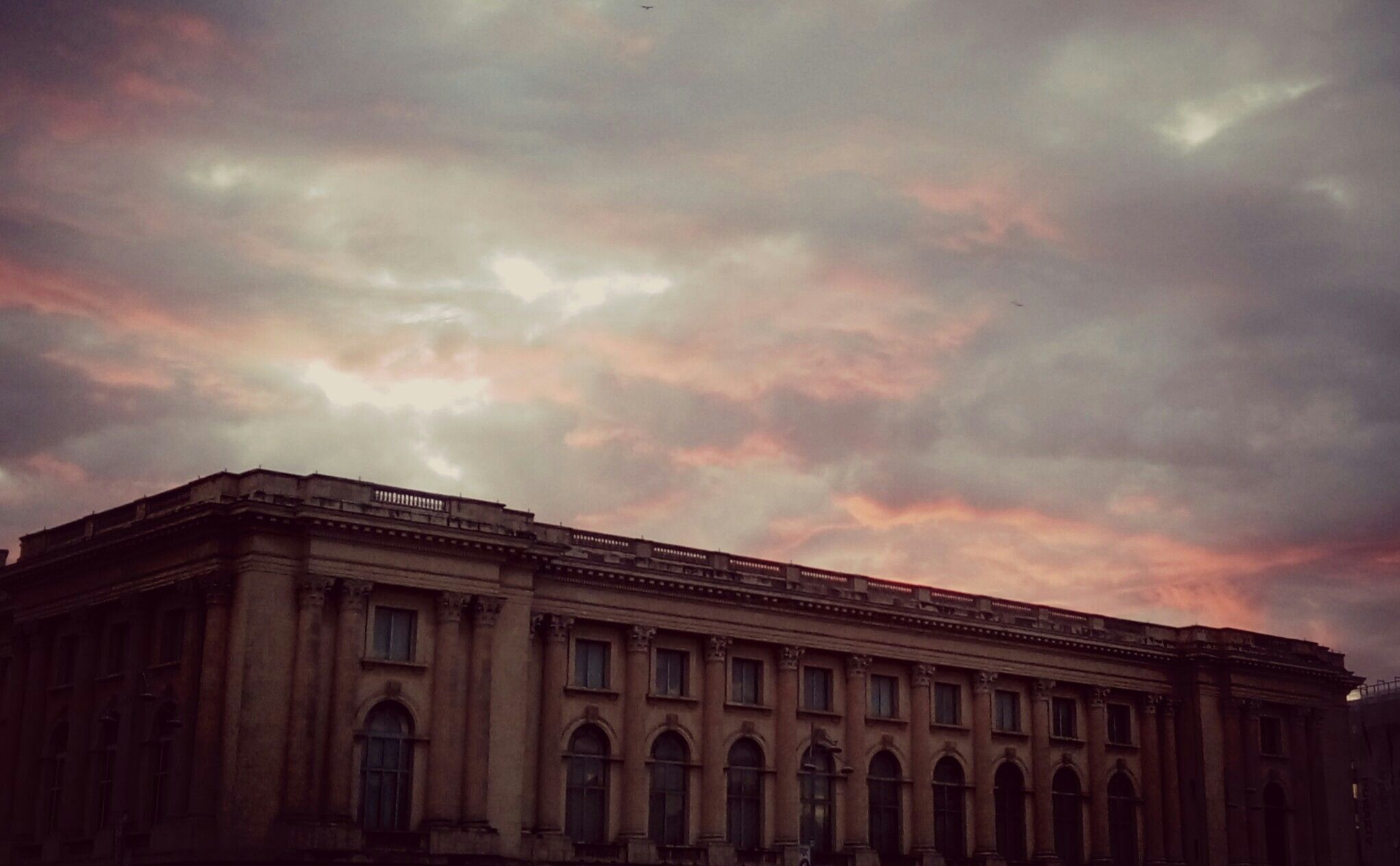 Art Museum. Sunset. Lights in the sky. Arhitecture.