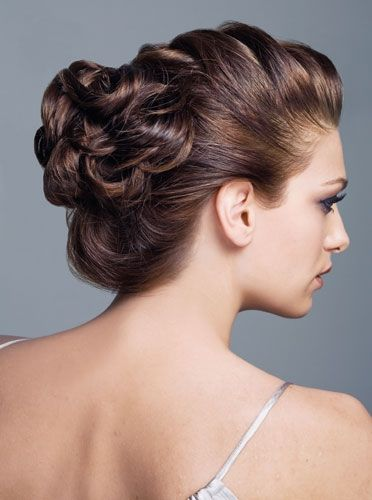 Beautiful.  It looks like a loose french braid with the ends gathered into pin curls.