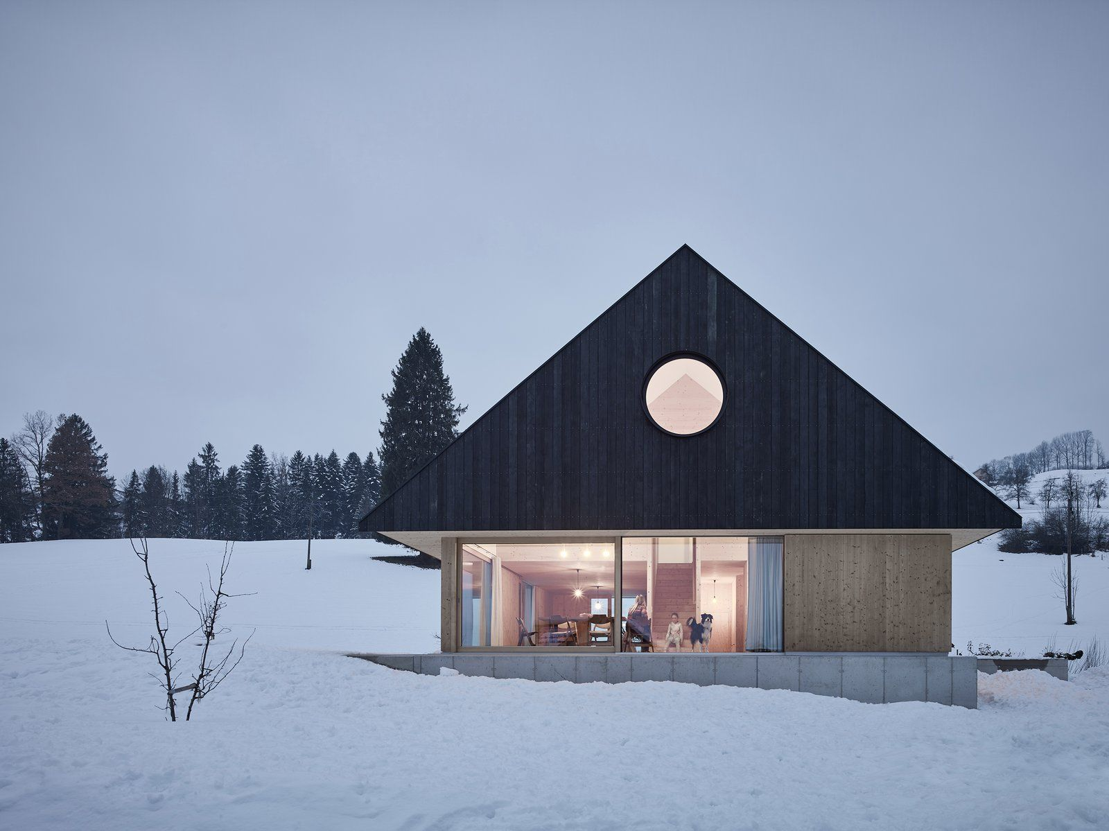 this sleek austrian home turns into a cozy light box at night in rh pinterest com