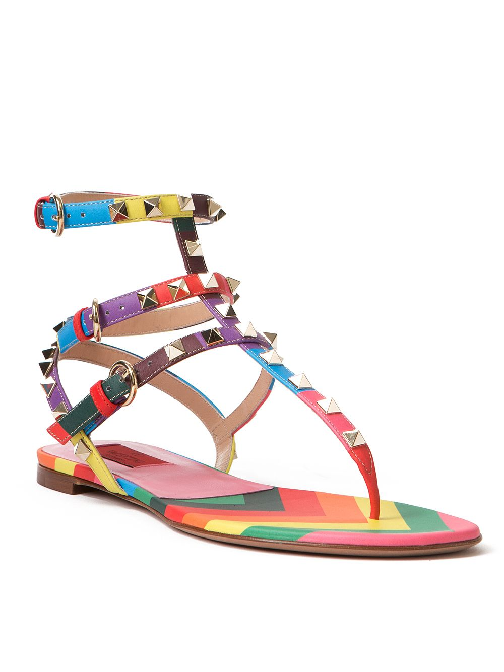 ec1365261b92 Rainbow Rockstud Gladiator Sandals from Valentino. Gladiator leather sandals  feature a T-strap design