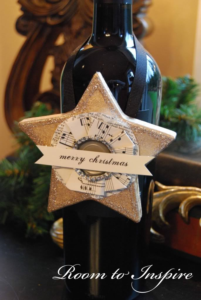 Decorate a bottle of wine and then hang on the tree. Great hostess gift or teacher gift.