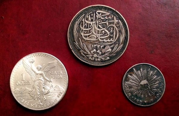 Old foreign coins just picked up... Onza, Piastres, and Reale