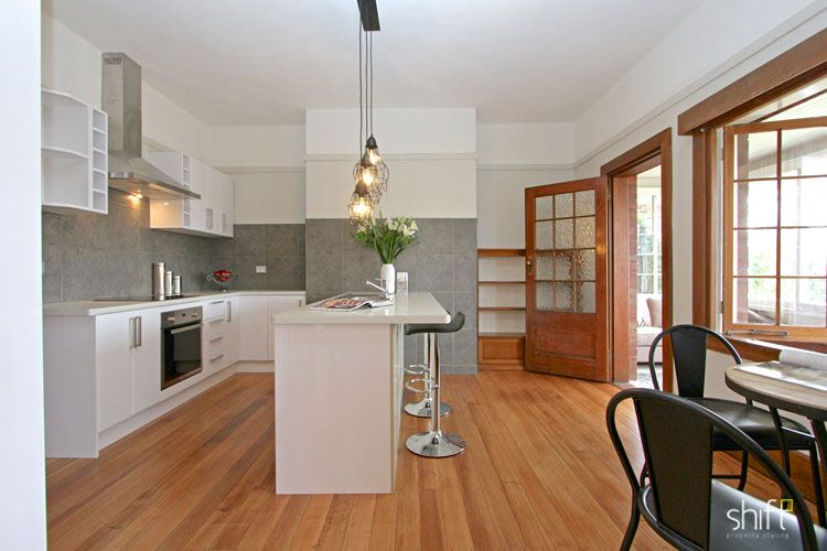 White kitchen off polished tasmanian oak floor boards