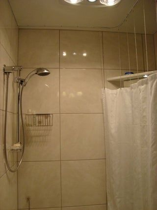 disappearing shower curtain for small bathrooms in 2020