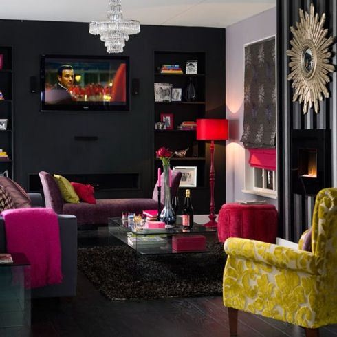 Dark grey walls with bright accents and good lighting. This is so fun!