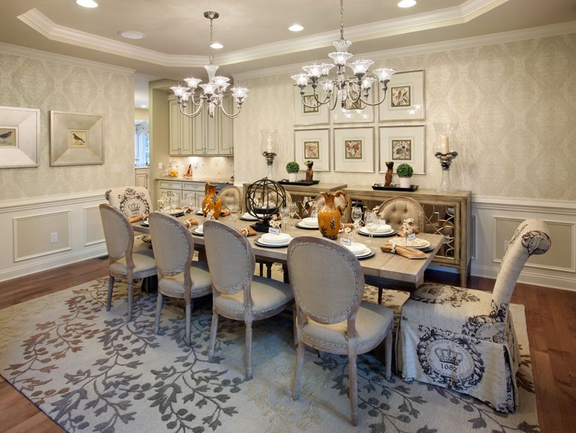 Toll Brothers Dining Setting Featuring Progress Lighting Roxbury Chandeliers