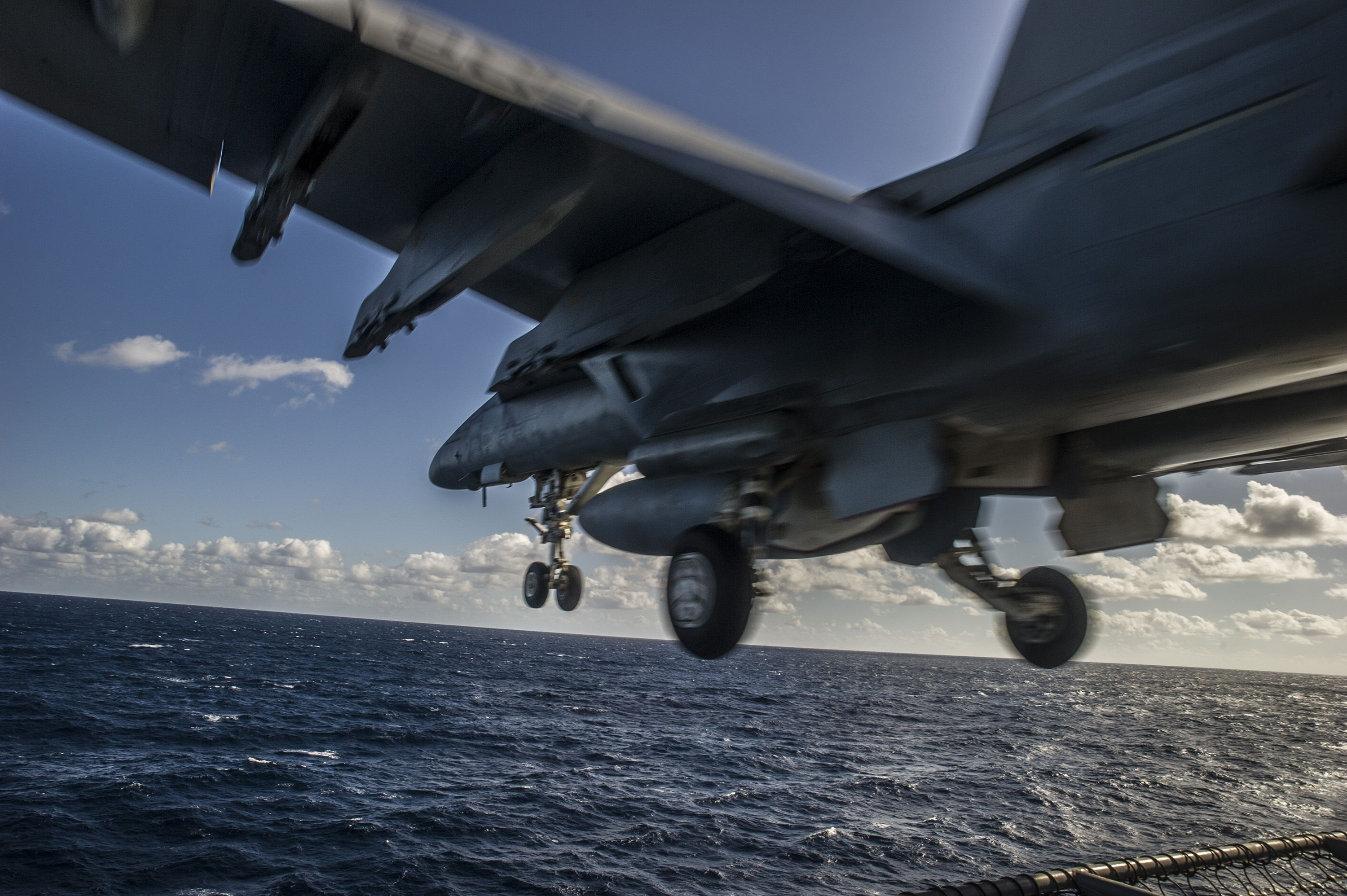PACIFIC OCEAN,Nov.21,2014.F/A-18E Super Hornet from Royal Maces of Strike Fighter Squadron (VFA) 27 launches from the flight deck of the Nimitz-class aircraft carrier USS George Washington (CVN 73) during the Carrier Air Wing (CVW) 5 fly-off. George Washington and its embarked air wing, CVW 5, provide a combat-ready force that protects and defends the collective maritime interests of the U.S. and its allies and partners in the Indo-Asia-Pacific region.(USN Mass Comm Spec 3rd Class Paolo…