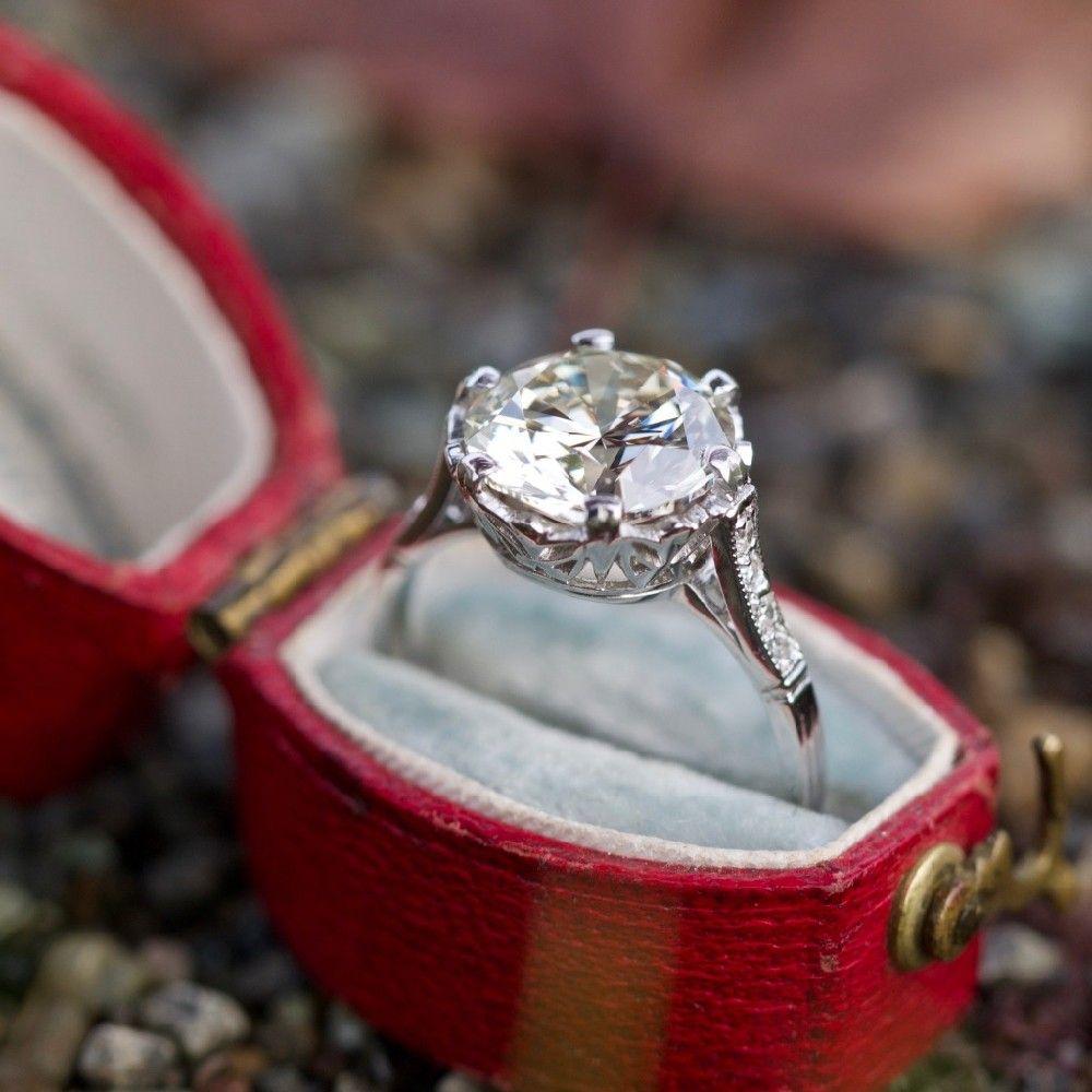 This magnificent low profile crown motif vintage diamond engagement