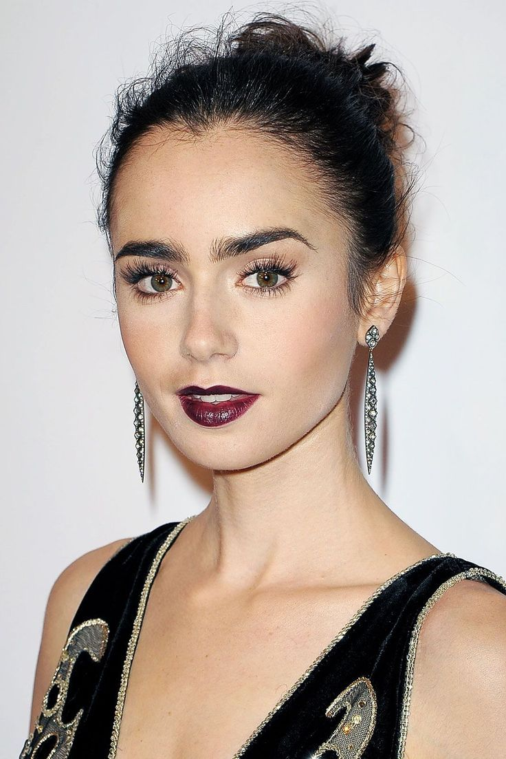 Lily Collins looks incredible in a dark berry lip
