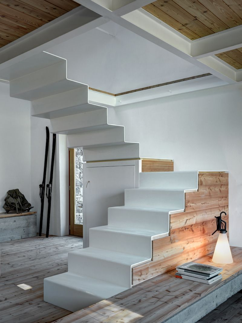 Home interior stairs staircase in white and wood home in the alps designed by architect