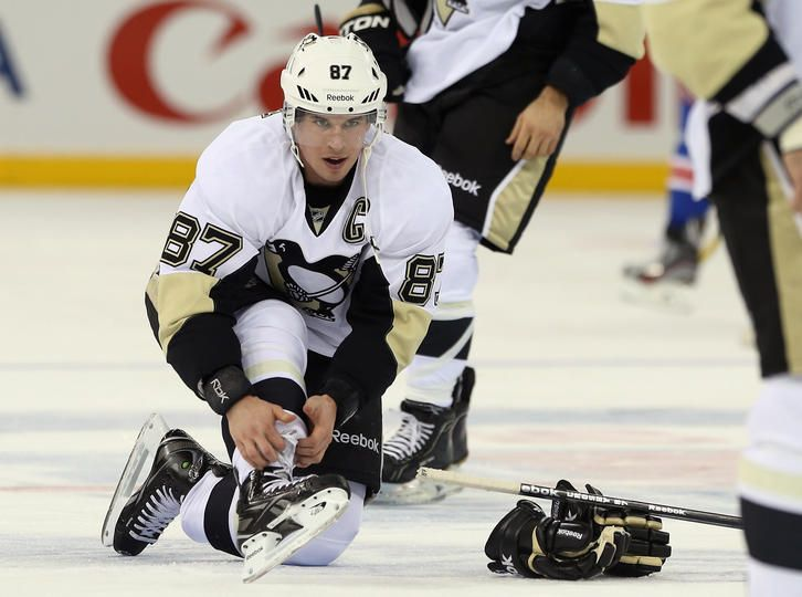 9dd5a8119 Sidney Crosby laces up before the second game of the season vs the New York  Rangers 1 20 13