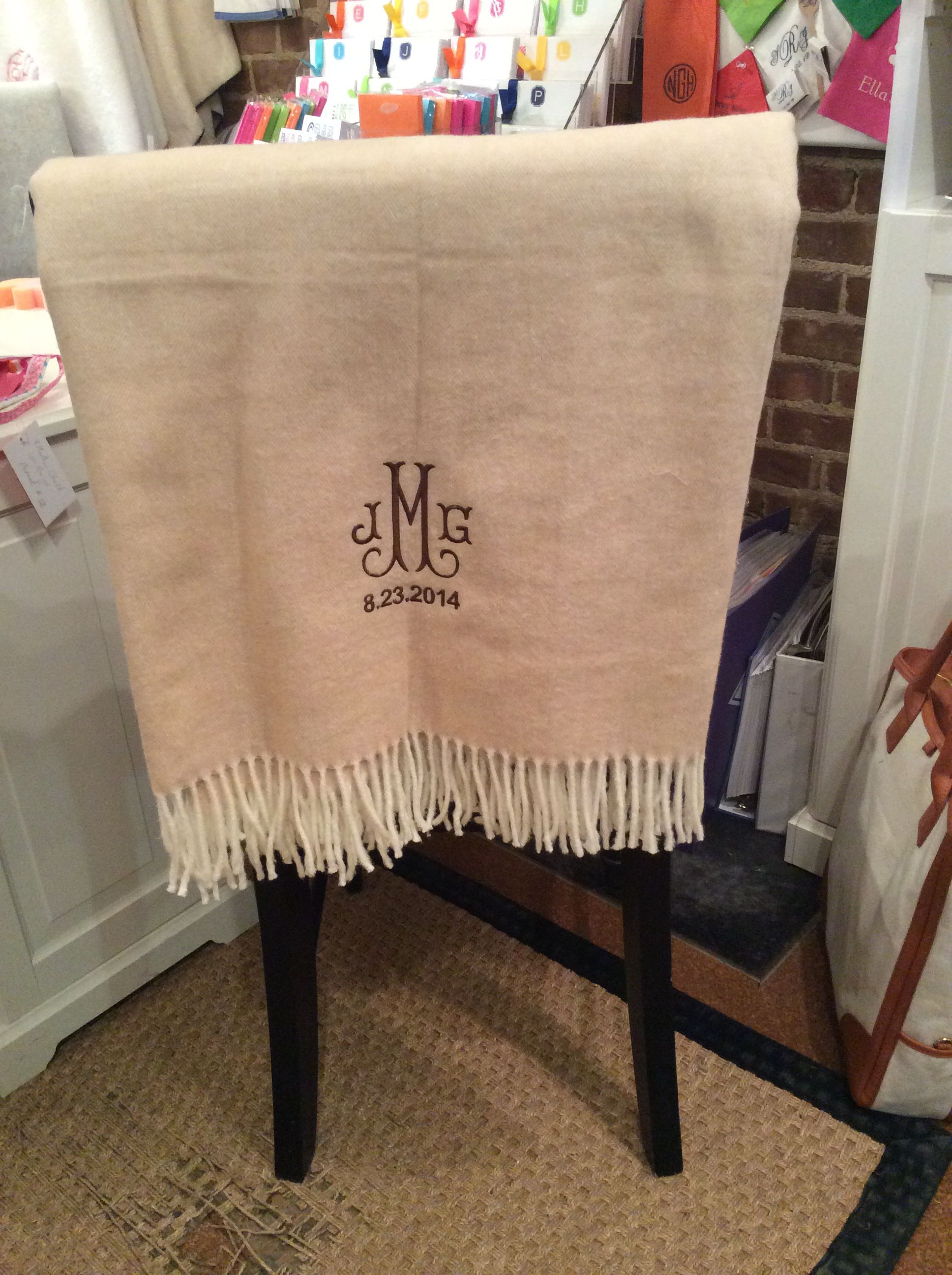 Beautiful monogrammed blanket with wedding date from Monograms off Madison