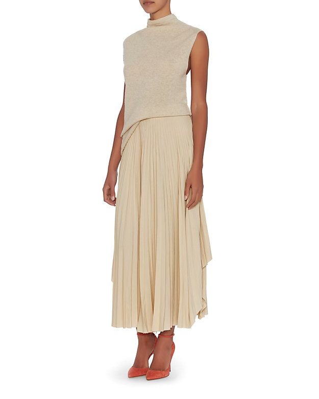 Helmut Lang Pleated Skirt: Oyster: A raw edge hem lends modern design to a feminine pleated midi skirt. Side zip closure. In oyster. Fabric: 59% acetate/41% silk Made in China. Model Measurements: Height 5'8.5 ; Waist 24 ; Bust 33 wearing size 2  Length from waistline to hem: ...