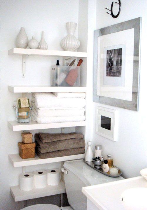 Photos On Bathroom wall shelves