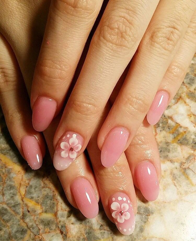 Pink oval shaped natural looking acrylic nails with flower design ...