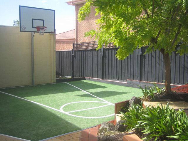 A synthetic grass basketball key is a great way to keep the kids active in the backyard.
