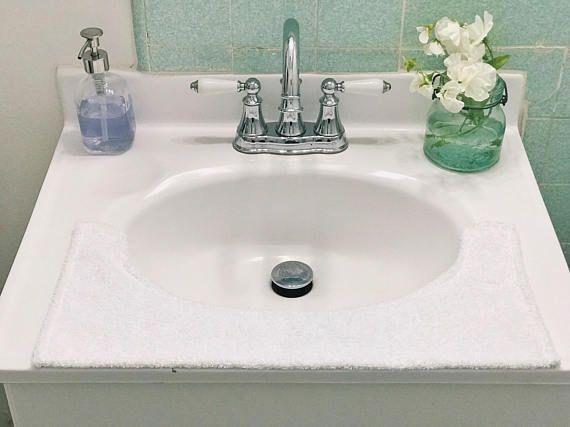 A Curved Towel That Sits On Your Bathroom Sink So Countertop Doesn T Get
