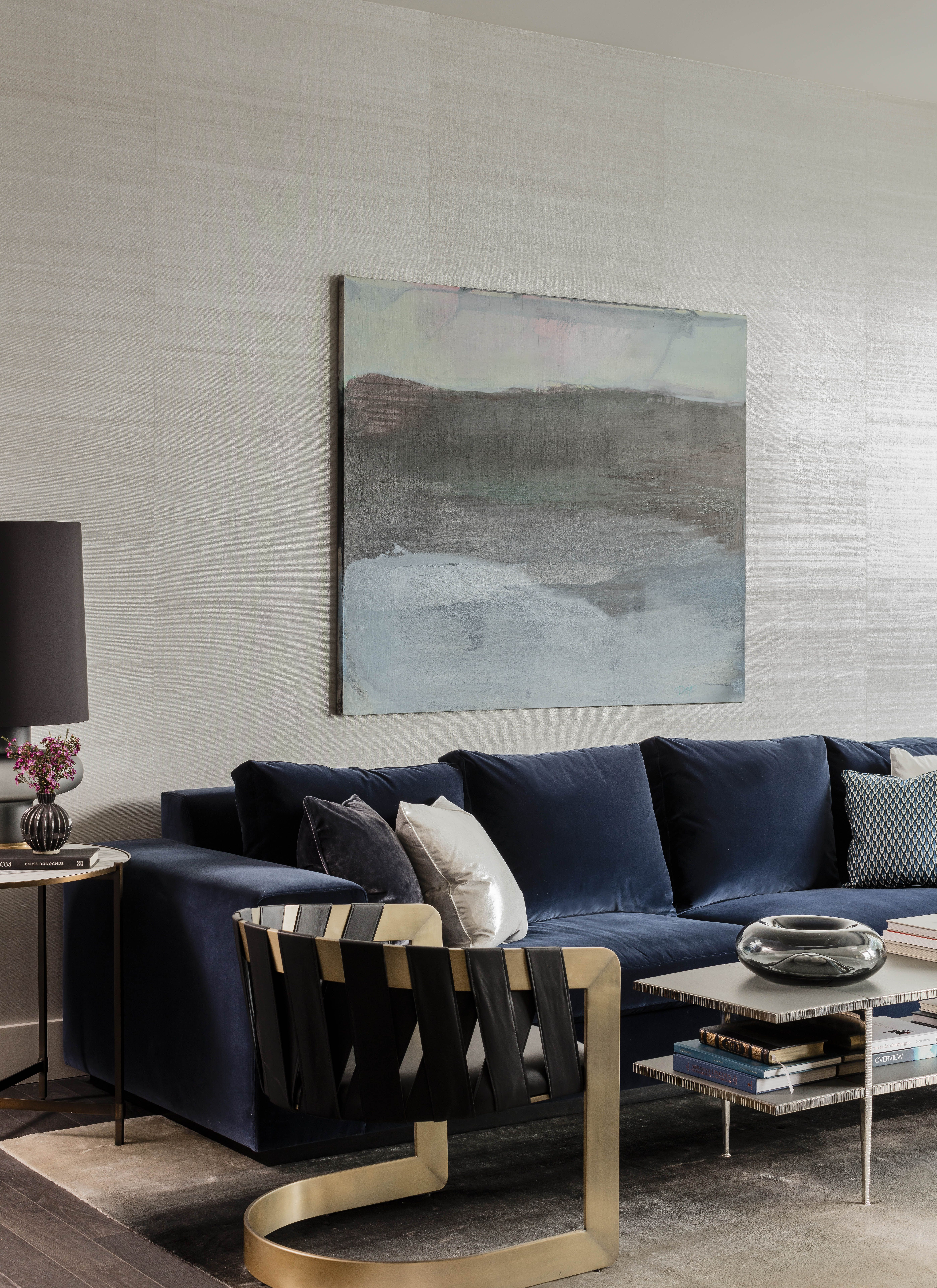 50 Liberty 1 Elms Interior Design Living Area With Navy Blue Sofa Silvery Gray Wallcovering And B Brass Living Room Blue Interior Design Black Living Room