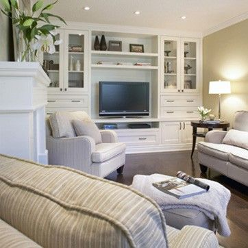 Basement built in tv -- nice, bright basement in neutral color scheme for wide appeal.