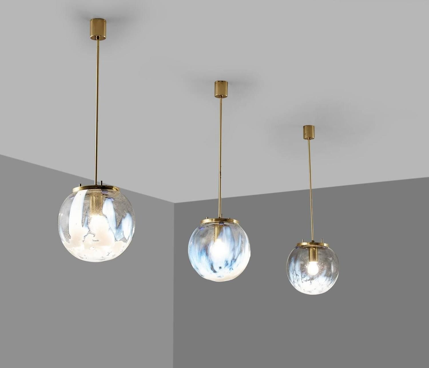 Large set of pendants in glass and brass italy s s
