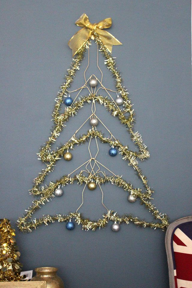 This Space Saving Tree Is Made Of Wire Hangers And It Hangs Flat On The Wall You Can Decorate I Flat Christmas Tree Wall Christmas Tree Hanger Christmas Tree